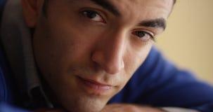 Closeup of worried Hispanic man sitting at desk Royalty Free Stock Photos