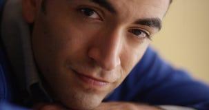 Closeup of worried Hispanic man sitting at desk Stock Photo