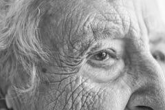 Closeup face of a senior person Stock Images