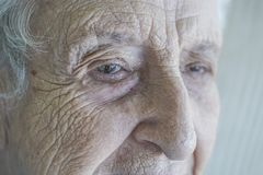Closeup face of a senior person crying Royalty Free Stock Image