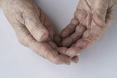 Closeup wrinkled hands of a senior person Stock Photo
