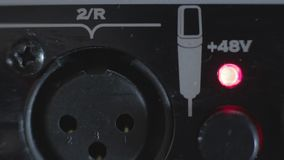 Closeup XLR microphone's socket ,turning on power stock video footage