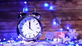 Closeup of Xmas set with big alarm clock counting to twelve o'clock stock video footage