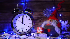 Closeup of Xmas set with big alarm clock counting to twelve o`clock stock video footage