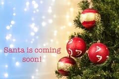 Closeup of xmas-tree decorations with Santa coming Stock Photo