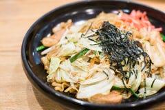Closeup yakisoba noodle. Japan yakisoba on wood table, vintage style stock image