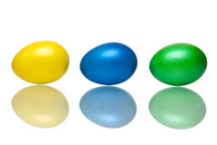 Closeup of yellow, blue and green Easter eggs Stock Image