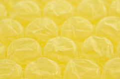 Closeup of Yellow Bubble Wrap with Room for Words Stock Images