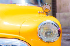 Closeup of yellow classic vintage car in Old Havana, Cuba. View of yellow classic vintage car in Old Havana, Cuba Stock Photo