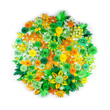 Closeup of yellow, green, orange and white paper quilling flowers arranged in circle Royalty Free Stock Photography