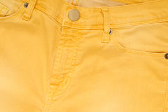 It is a closeup of yellow jeans. royalty free stock photo