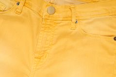 It is a closeup of yellow jeans. Royalty Free Stock Images