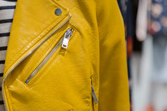 Closeup of yellow leather jacket with zipper Stock Photo