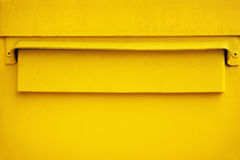 Yellow postbox Royalty Free Stock Image