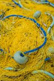 Detail of yellow nets on a boat deck. Closeup of a yellow nets on a fisherman boat deck in Zante Island, Greece stock photos