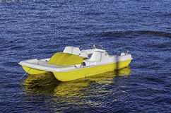 Closeup of a yellow pedal boat in Sardinia Italy. Stock Images