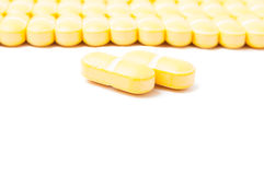 Closeup or yellow pills Stock Images