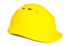Closeup of yellow protective helmet on white background Stock Images