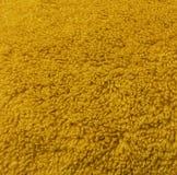Closeup yellow towel fabric texture stock image