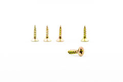 Closeup yellow zinc coated screw isolate on white background Royalty Free Stock Photography