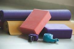 Closeup of yoga blocks belts and mat props. Indoor Stock Image
