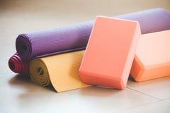 Closeup of yoga props indoor. Closeup of yoga blocks and mat props indoor Stock Photography
