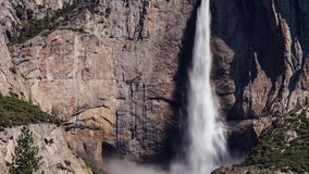 Closeup of Yosemite Falls Motion Time-lapse. A motion time-lapse of mid day light over Yosemite Falls, California stock video