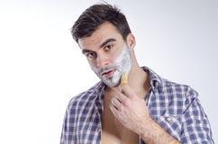 Closeup young adult Caucasian putting shaving foam stock photos