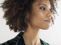 Closeup Of Young Afro Woman. Closeup of a young afro woman with curly hair against white background Stock Images
