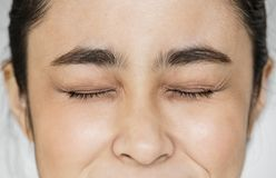 Closeup of Young Asian girl portrait eyes closed Royalty Free Stock Photography