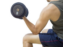 Closeup of a young athlete man lifting weights. At sport club,Isolated on white background with Clipping path Royalty Free Stock Images