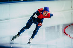 Closeup young athlete skater during race sprint distance along path of ice Palace Royalty Free Stock Photo