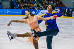 Closeup young athletes figure skaters on ice sports arena Stock Image