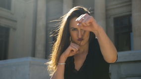 Closeup of young attractive woman provoking and punching stock video footage