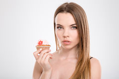 Closeup of young beautiful woman with cupcake Royalty Free Stock Image