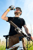 Closeup of a young biker drinking water Stock Photography