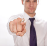 Closeup of a young business man  pointing at you Royalty Free Stock Photos