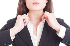 Closeup with young business woman hands adjusting shirt collar Royalty Free Stock Photography