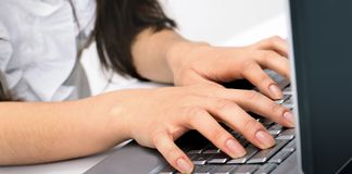 Closeup.young business woman typing on the laptop keyboard. People and technology Stock Images