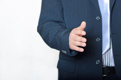 Closeup of young businessman giving hand Royalty Free Stock Image
