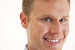 Closeup of young businessman smiling. Portrait of confident young businessman smiling Royalty Free Stock Photos