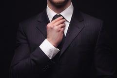 Closeup of young businessman suit Stock Photography