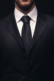 Closeup of young businessman suit Royalty Free Stock Image