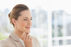 Closeup of a young businesswoman looking away Stock Photo