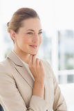 Closeup of a young businesswoman looking away Stock Photography
