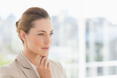 Closeup of a young businesswoman looking away Stock Image