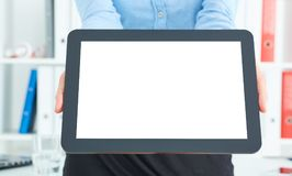 Closeup of a young businesswoman offering to you a brand new pad with blank screen. royalty free stock photography