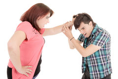 Closeup of a young casual couple pulling hair Stock Photo