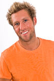 Closeup of young Caucasian male in a bright orange t-shirt Royalty Free Stock Photo