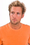 Closeup of young Caucasian male in a bright orange t-shirt. A young blonde, Caucasian, male with blue eyes in a bright orange t-shirt Stock Images